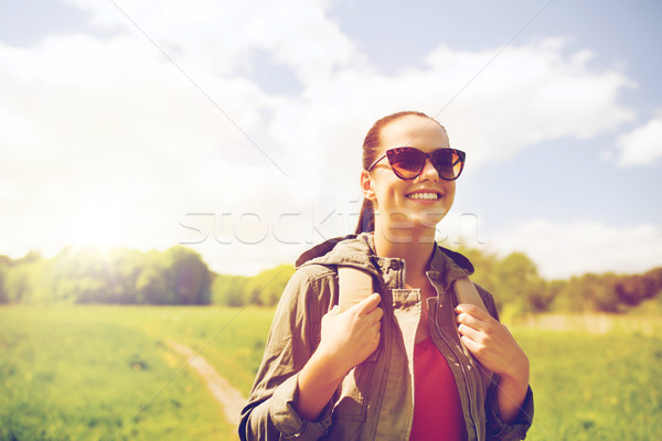 happy young woman with backpack hiking outdoors Stock photo © dolgachov