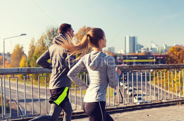 happy couple running outdoors Stock photo © dolgachov