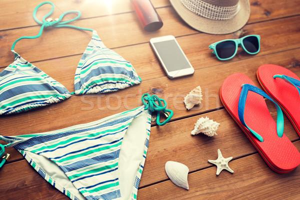 close up of smartphone and beach stuff Stock photo © dolgachov
