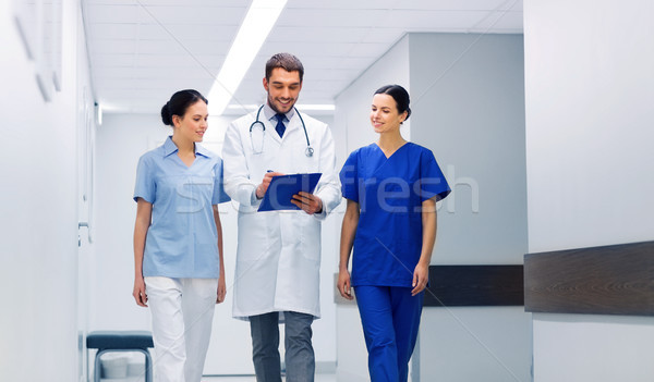 group of medics at hospital with clipboard Stock photo © dolgachov