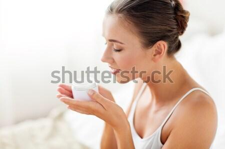 Glücklich Frau halten Sahne Schönheit Stock foto © dolgachov