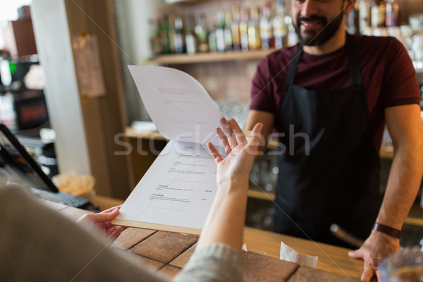 bartender and customer menu at bar Stock photo © dolgachov