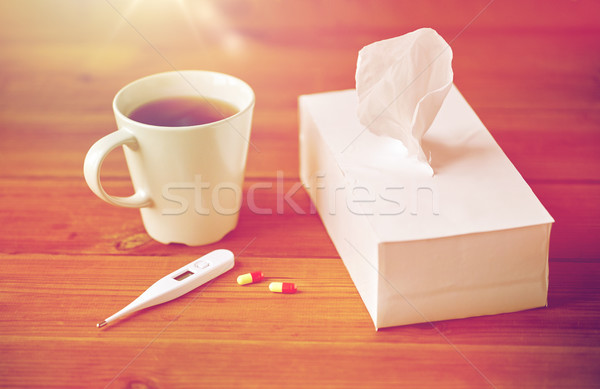 cup of tea, paper wipes and thermometer with pills Stock photo © dolgachov