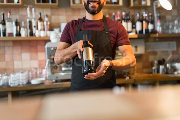 Feliz hombre barman botella pequeña empresa Foto stock © dolgachov
