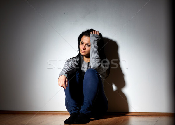 unhappy woman crying on floor at home Stock photo © dolgachov
