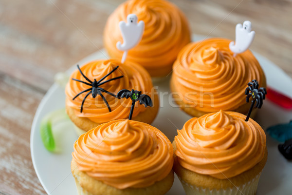 halloween party decorated cupcakes on plate Stock photo © dolgachov