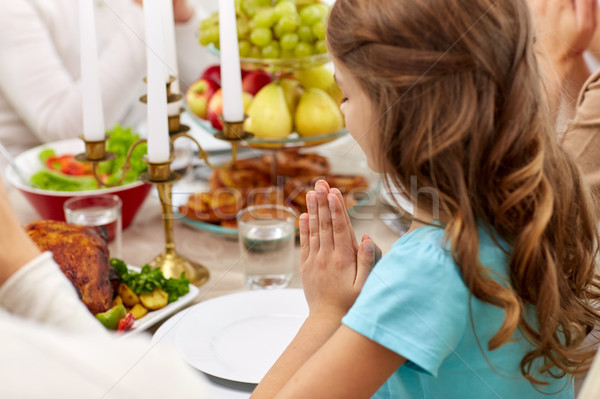 girl with family having dinner and praying at home Stock photo © dolgachov