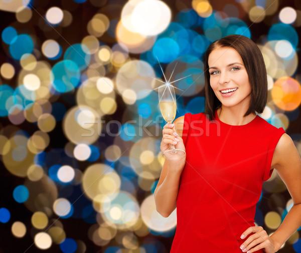 Mosolygó nő tart üveg pezsgő bor buli Stock fotó © dolgachov