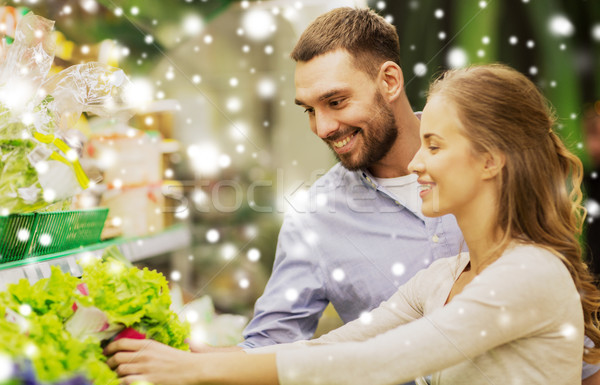 happy couple buying lettuce at grocery store Stock photo © dolgachov