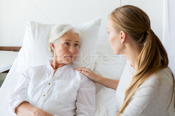 daughter visiting her senior mother at hospital Stock photo © dolgachov