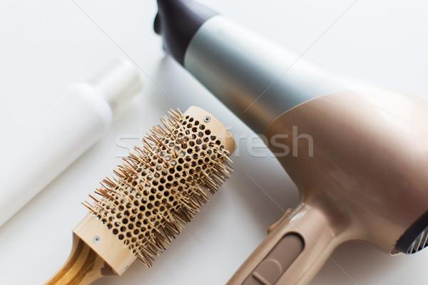 hairdryer, brush and hot styling hair spray Stock photo © dolgachov