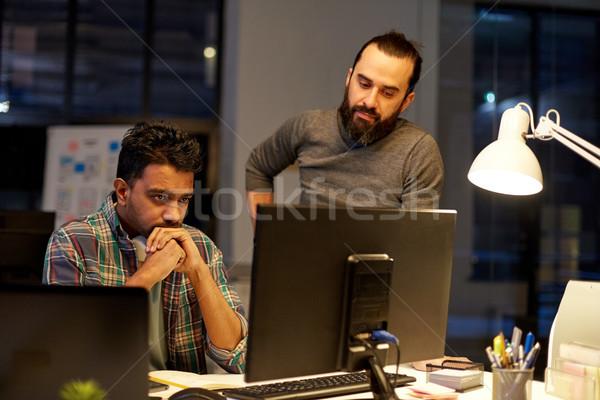 Creatieve team computer werken laat kantoor Stockfoto © dolgachov