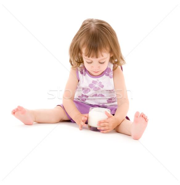 Petite fille verre yaourt photos alimentaire enfant Photo stock © dolgachov