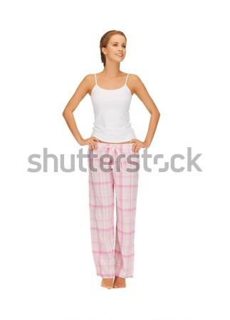 Felice donna sorridente cotone pigiama luminoso foto Foto d'archivio © dolgachov