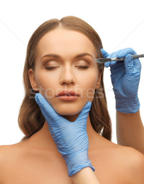 woman face and beautician hands Stock photo © dolgachov