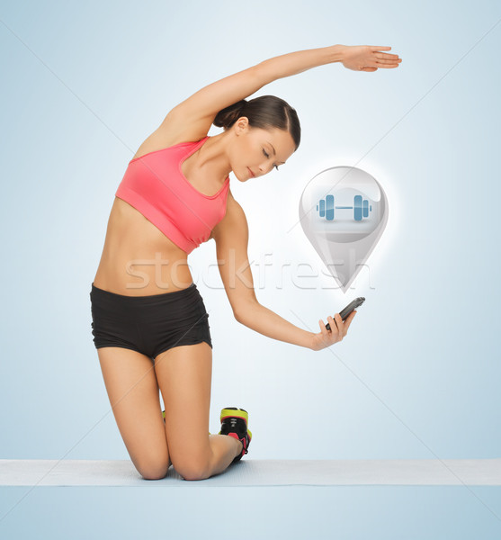 beautiful sporty woman doing exercise Stock photo © dolgachov