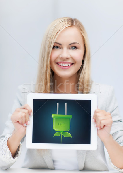 woman with tablet pc with electrical eco plug Stock photo © dolgachov