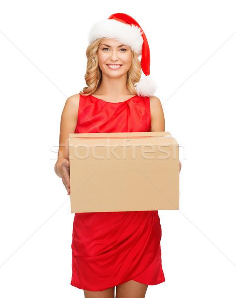 smiling woman in santa helper hat with parcel box Stock photo © dolgachov
