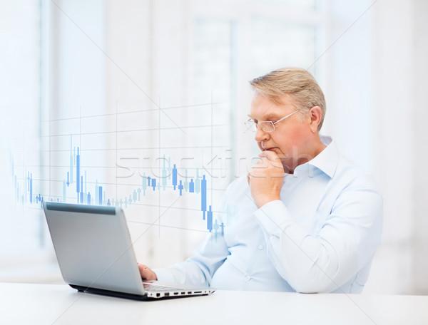 old man in eyeglasses working with laptop at home Stock photo © dolgachov