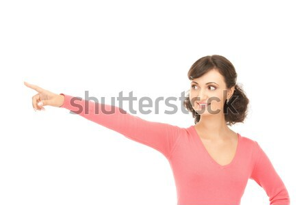 smiling teenager pointing her finger up Stock photo © dolgachov