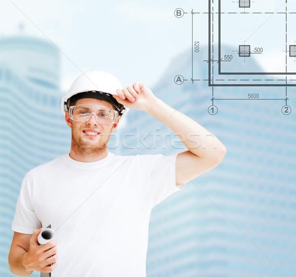 male architect in white helmet with blueprint Stock photo © dolgachov