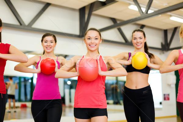 Pessoas do grupo estabilidade fitness esportes Foto stock © dolgachov