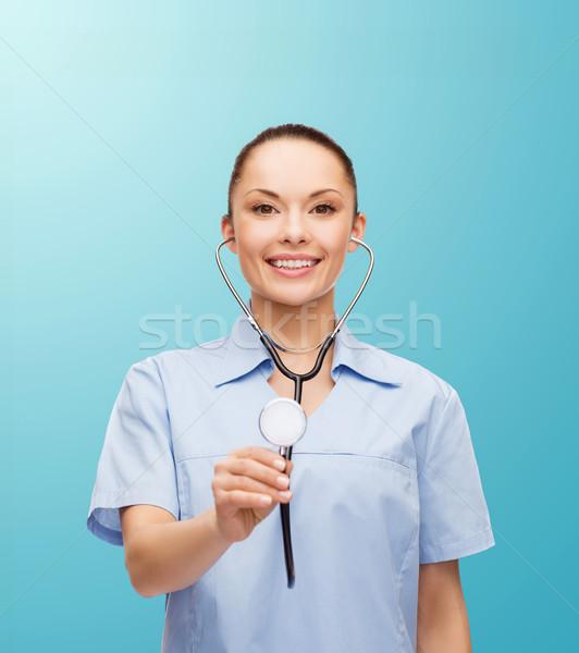 smiling female doctor or nurse with stethoscope Stock photo © dolgachov