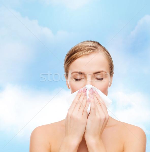 beautiful woman with paper tissue Stock photo © dolgachov