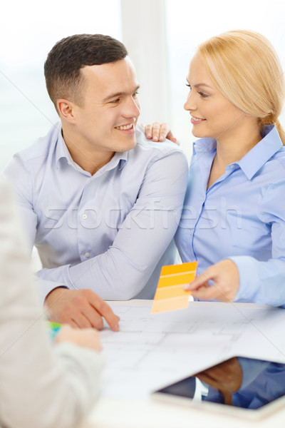 couple looking at blueprint and color samples Stock photo © dolgachov
