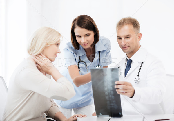 doctors with patient looking at x-ray Stock photo © dolgachov