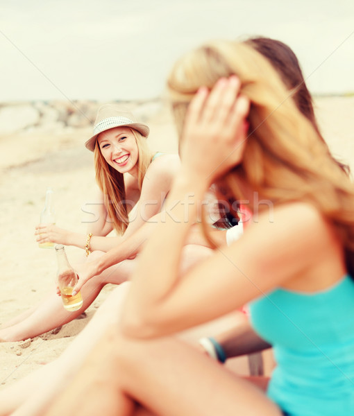 Stock photo: girls with drinks on the beach