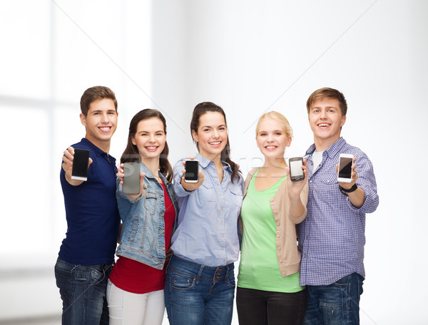 students showing blank smartphones screens Stock photo © dolgachov