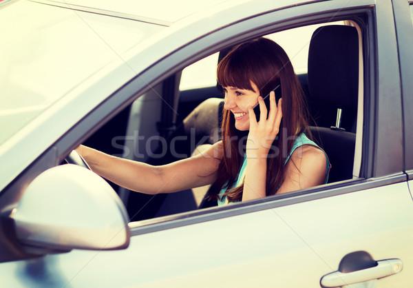 woman using phone while driving the car Stock photo © dolgachov