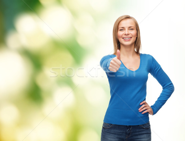 smiling girl in casual clothes showing thumbs up Stock photo © dolgachov