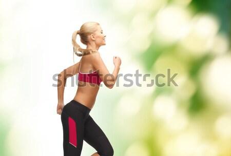 ストックフォト: スポーティー · 女性 · を実行して · ジャンプ · フィットネス · ダイエット