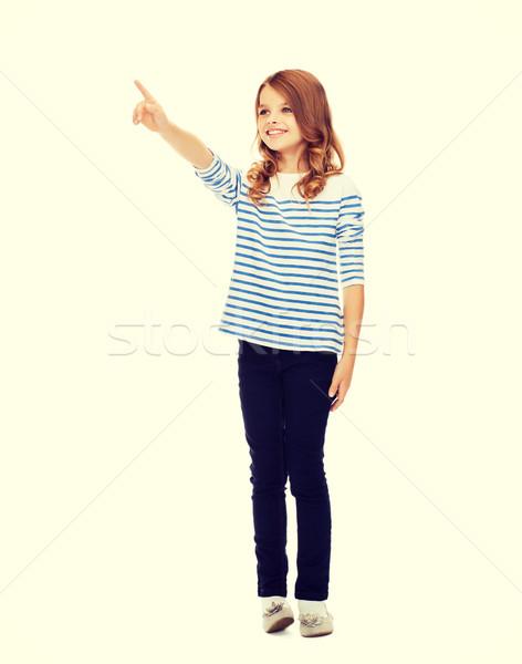 Lány mutat képzeletbeli képernyő oktatás iskola Stock fotó © dolgachov