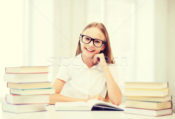 student girl studying at school Stock photo © dolgachov