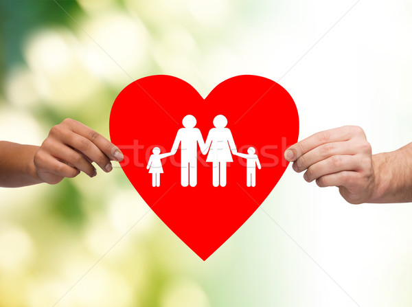 closeup of hands holding red heart with family Stock photo © dolgachov
