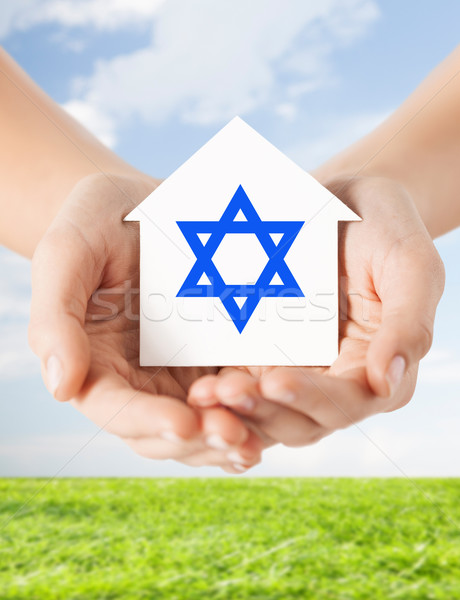 close up of hands holding house with star of david Stock photo © dolgachov