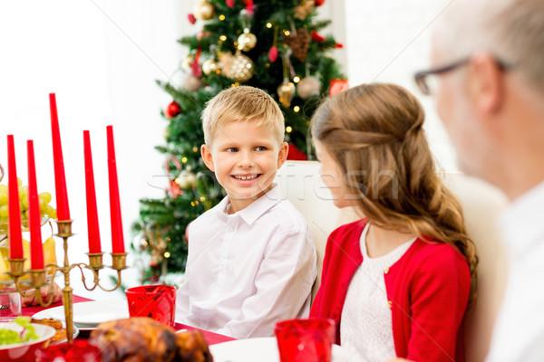Mosolyog család ünnep vacsora otthon ünnepek Stock fotó © dolgachov