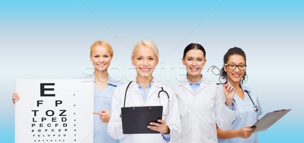 Souriant Homme oeil médecins santé Photo stock © dolgachov