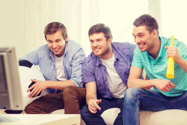 happy male friends with football and vuvuzela Stock photo © dolgachov