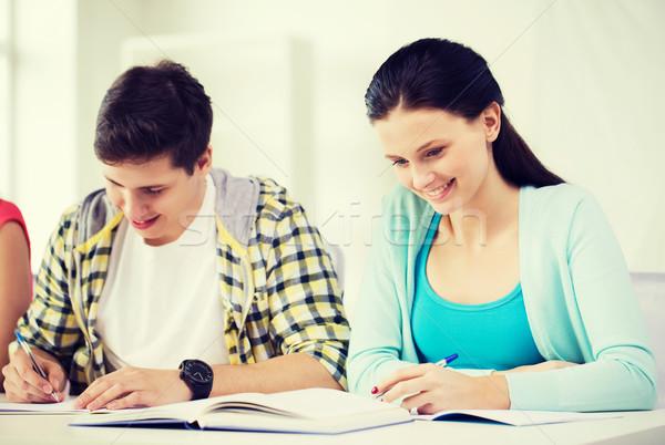 Diákok tankönyvek könyvek iskola oktatás kettő Stock fotó © dolgachov