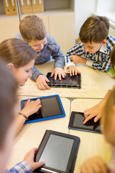 group of school kids with tablet pc in classroom Stock photo © dolgachov