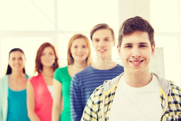 Mosolyog férfi diák csoport osztálytársak barátság Stock fotó © dolgachov