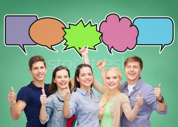 Grupo sonriendo adolescentes texto burbujas escuela Foto stock © dolgachov