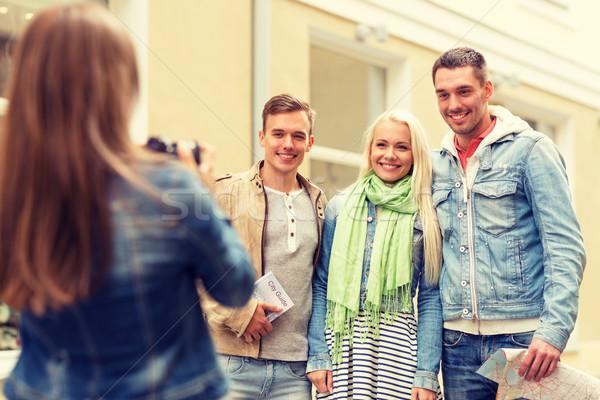 group of smiling friends taking photo outdoors Stock photo © dolgachov