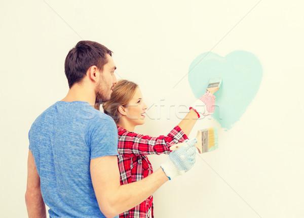 Gülen çift Boyama Küçük Kalp Duvar Stok Fotoğraf Syda