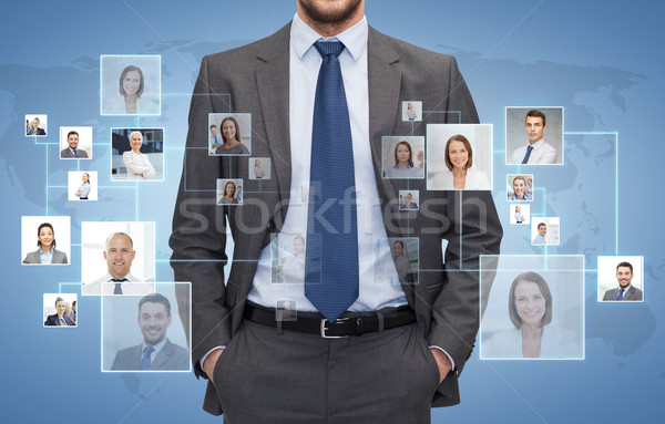 close up of businessman over icons with contacts Stock photo © dolgachov