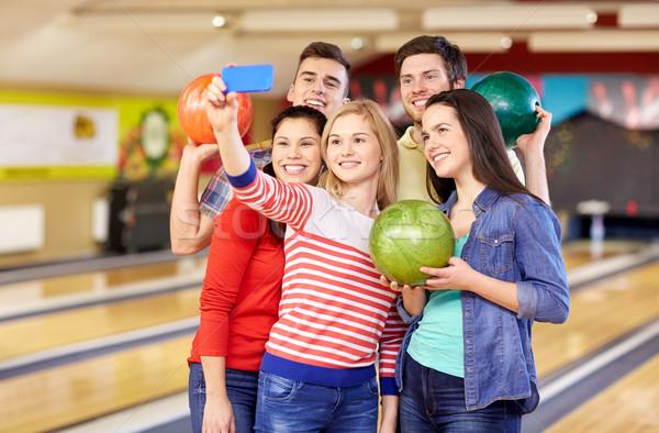 Feliz amigos bolera club personas Foto stock © dolgachov